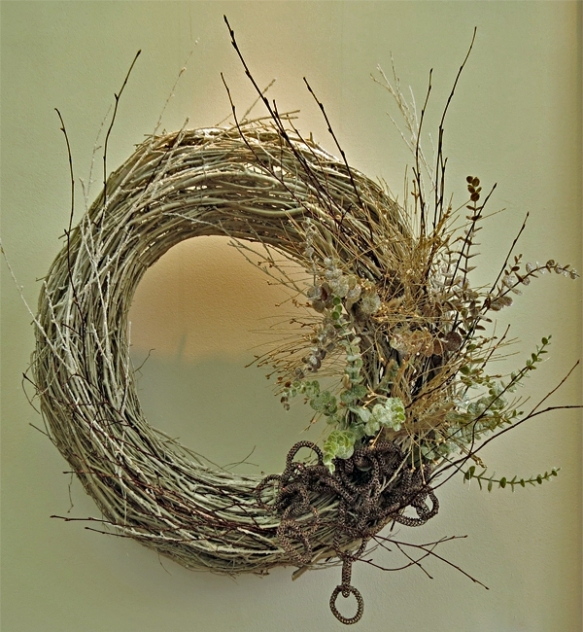 Frosted Fields by Katherine McPheeters - The wintry beauty of a frosted field is depicted by a twig wreath and a collection of frosted stems in shades of champagne and chocolate