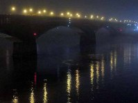 The Eads Bridge on a Dark and Foggy Night