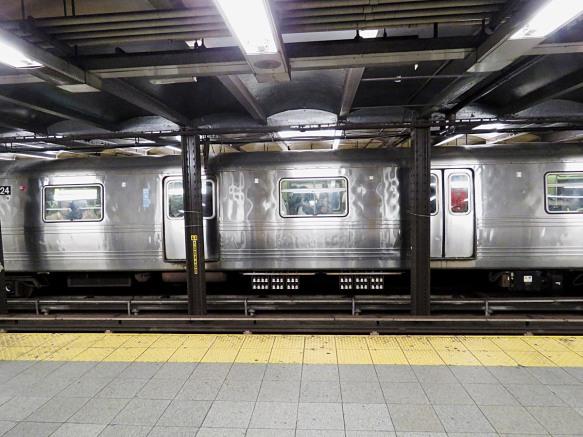 Passing Subway Car Flashing Across the Tracks
