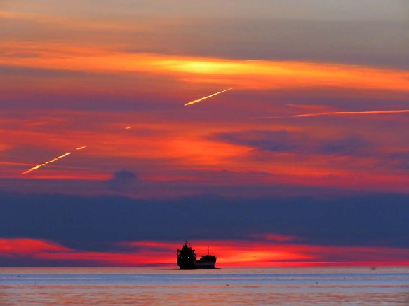 Fiery Sunset, Contrails and Lake Boat