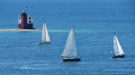 Sailboats Passing Round Island Lighthouse