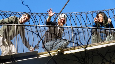 Rey, Dave and Becca caged up high in Monstros